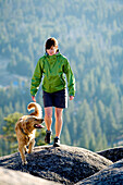 Rosie Hackett hiking with her dog high in the mountains in South Lake Tahoe, California.