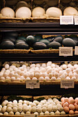 A variety of eggs including duck, emu and ostrich eggs sit waiting to be selected by shoppers at Whole Foods in Fairfax, Virginia.