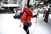 Writer Mike Lanza hikes away from a hut while on a trip in Preston Park to take measurements in an effort to study climate change effects on the Glaciers in Glacier National Park, Montana.