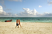 A couple dances on a beach of Isla Mujeres, near Cancun, Mexico. The area is known for it's beautiful beaches, first-class resorts and outdoor, nautical activities.