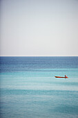 A man drifts in his boat on the blue waters off the beaches of Varadero, Cuba. The cuban government has long been trying to make Varadero the cuban equivalent of Cancun.