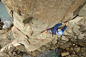 Dana Ikeda lead climbing The Moai, Tasmania, Australia