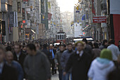 Istanbul, Turkey - January, 2008: The busy pedestrian street called Istiklal which leads up to Taksim square in Istanbul, Turkey is home to many of the cities most popular shops, bars and cafes and has an old fashioned tram running its length .