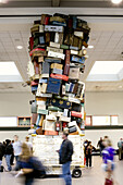 'In 1998, sculptor Brian Goggin built in a sense of wonder and humor for patrons of Terminal A's baggage claim. The two 23-foot pillars of colorful, old suitcases seemingly ready to topple from the luggage cart below cause visitors to point, gasp and keep