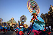 Quetzalines dance outside the Basilica of Guadalupe in Mexico City, December 11, 2007.  Hundreds of thousands of Mexican pilgrims converged on the Basilica, bringing images to be blessed, as processions filled the streets for the feast day of Our Lady of
