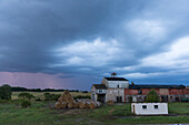 Thunderstorm over a farm, Schorfheide-Chorin Biosphere Reserve, Neudorf, Friedenfelde, Uckermark, Brandenburg, Germany