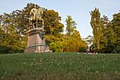 People relaxing on the lawn in Hofgarten Garden, Coburg, Franconia, Bavaria, Germany