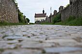 Cobblestone pilgrimage path to Valentinuskapelle chapel on Kapellenberg, Frickenhausen, near Ochsenfurt, Franconia, Bavaria, Germany