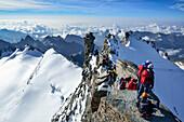 Several persons ascending on ridge to Gran Paradiso, Gran Paradiso, Gran Paradiso Nationalpark, Graian Alps range, valley of Aosta, Aosta, Italy