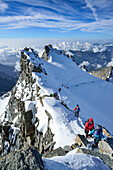 Several persons ascending on ridge to Gran Paradiso, Gran Paradiso, Gran Paradiso Nationalpark, Graian Alps range, valley of Aosta, Aosta, Italy