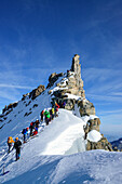 Several groups of persons standing on ridge of Gran Paradiso, Gran Paradiso, Gran Paradiso Nationalpark, Graian Alps range, valley of Aosta, Aosta, Italy