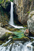 Waterfall cascading over boulders, Natural Park Mont Avic, Graian Alps range, valley of Aosta, Aosta, Italy