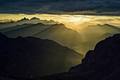 Beams of light over Dolomites with Marmolada, Antelao, Pelmo and Civetta, Rifugio Torre di Pisa, Latemar range, Dolomites, UNESCO world heritage Dolomites, Trentino, Italy