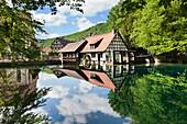 Mill reflecting in Blautopf Spring, Blaubeuren, Swabian Alb, Baden Wurttemberg, Germany, Europe