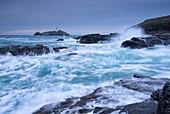 Crashing Atlantic waves in winter near Godrevy Lighthouse, Cornwall, England, United Kingdom, Europe