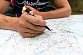 Man writing on a map, Marielyst, Falster, Denmark
