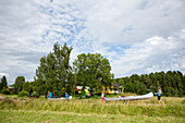 Family transporting canoes and luggage along a road from lake Glafsfjorden to lake Vaermeln, Vaermland, Sweden