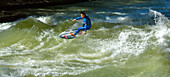 Surfer on the Eisbach river in the English Gardens, Munich, Upper Bavaria, Bavaria, Germany