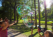 Bubbles in the English Gardens, Munich, Upper Bavaria, Bavaria, Germany