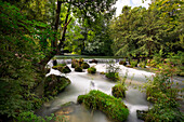 Eisbach waterfall in the English Garden, Munich, Upper Bavaria, Bavaria, Germany
