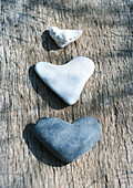Heart-shaped stones on wood