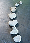 Heart-shaped stones arranged in curved line