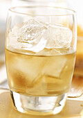 Whiskey with ice cubes, close-up