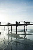 Pier with several dinner tables and chairs, Zanzibar, Tanzania