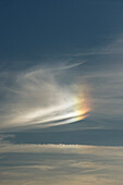 Cloudscape with partial rainbow