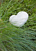 Heart shaped stone in long grass
