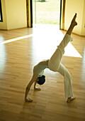 Woman doing one-legged bridge pose