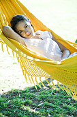 Woman resting in hammock, waist up