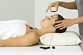 Woman receiving lastone therapy, eyes closed