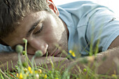 Man napping on meadow, close-up