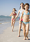 Girls running and walking on beach