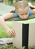 Girl reading book on hammock