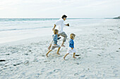 Family on beach, running