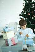 Boy opening Christmas presents
