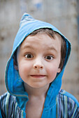 Little boy looking at camera with surprised expression, portrait