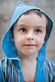 Little boy looking up in thought, portrait