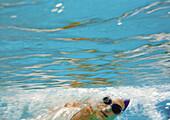 Woman underwater, underwater view.