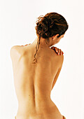 Nude woman, waist up, rear view