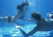 Man and woman swimming underwater