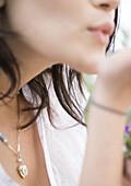 Woman blowing kiss, close-up