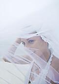 Bride, veil flying in wind