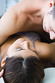 Man lying on top of woman, cropped view