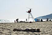 Teen girl sunbathing on beach