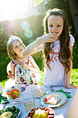 Girls eating sweets at birthday party