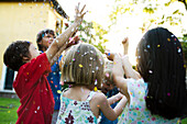 Children showered in falling confetti