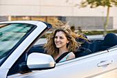 Young woman driving convertible